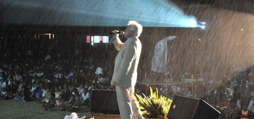 Pastor John Carter preaching in the rain.